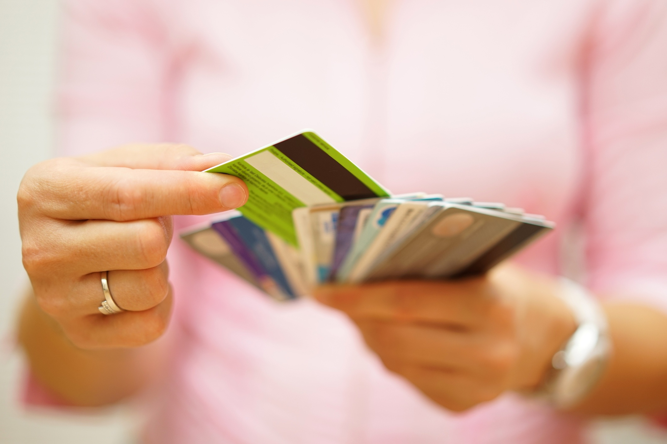 person holding prepaid cards