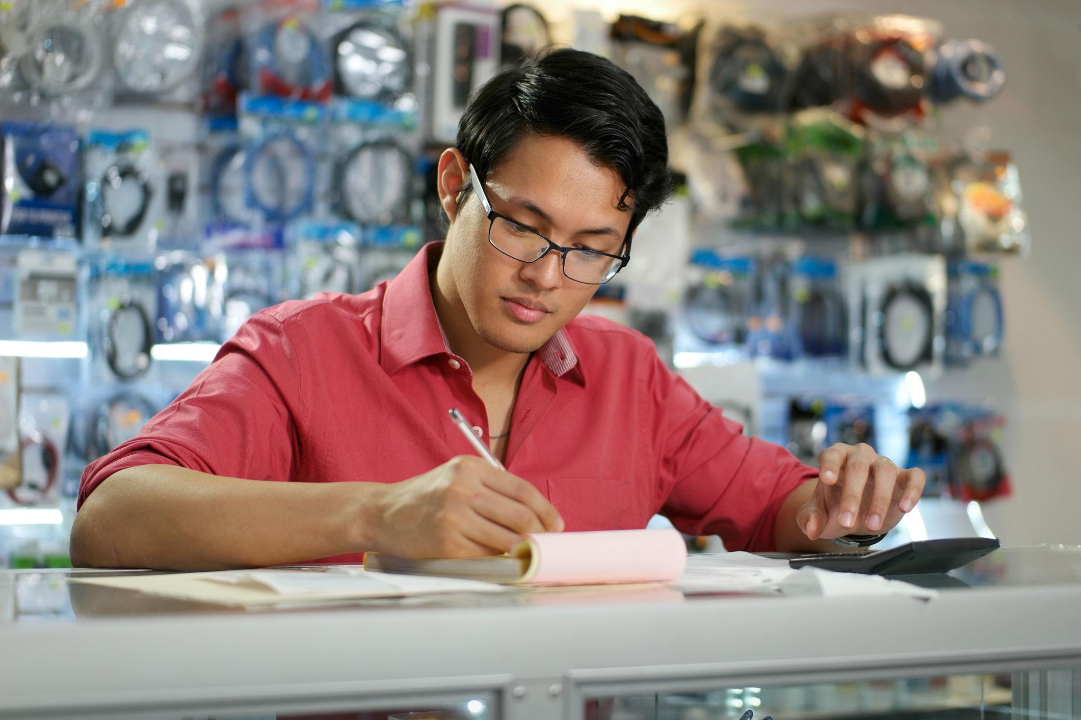 Store clerk writing